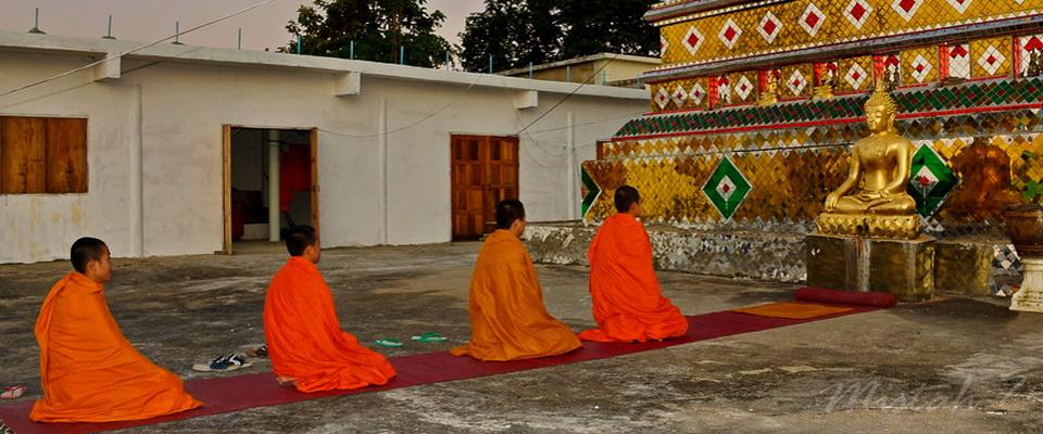 Novices in front of Buddha